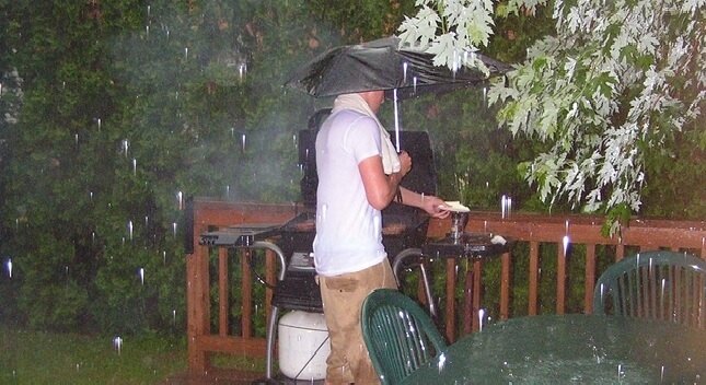 Dads That Cook on the Grill in Bad Weather