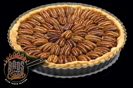 homemade pecan pie isolated on black background
