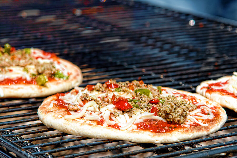 Pizza Cooking On Charcoal Grill